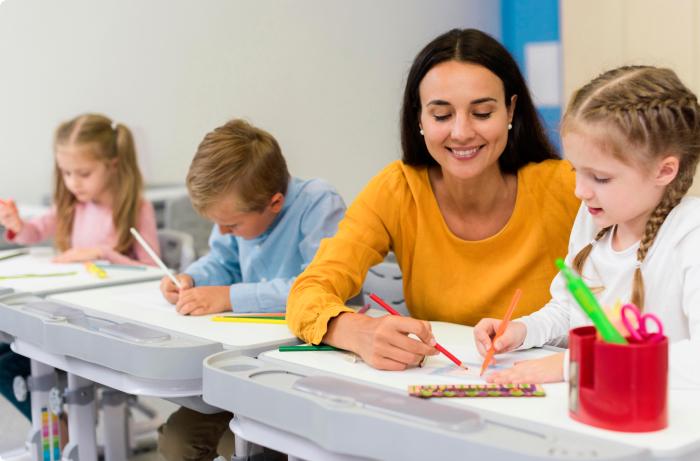 Happy Teacher Helping Her Students 1